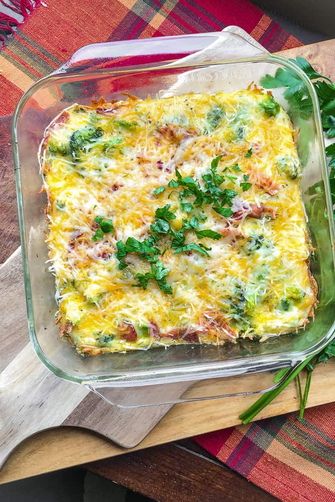 egg casserole in glass baking dish on table