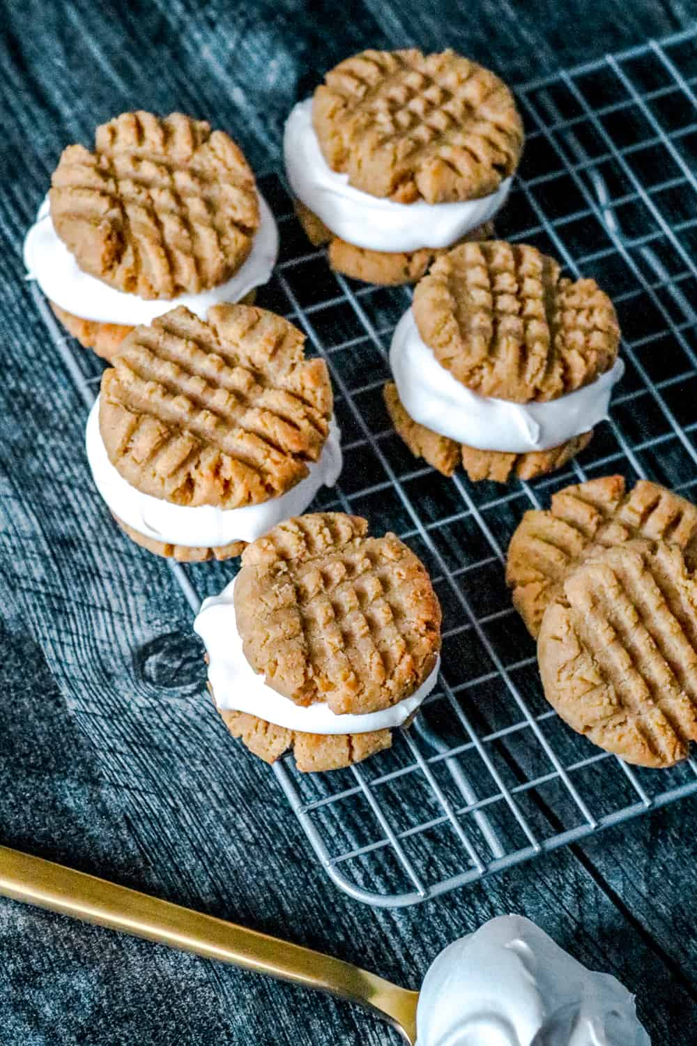 Ice cream sandwiches line up on cooling rack, for keto friendly ice cream filled cookies
