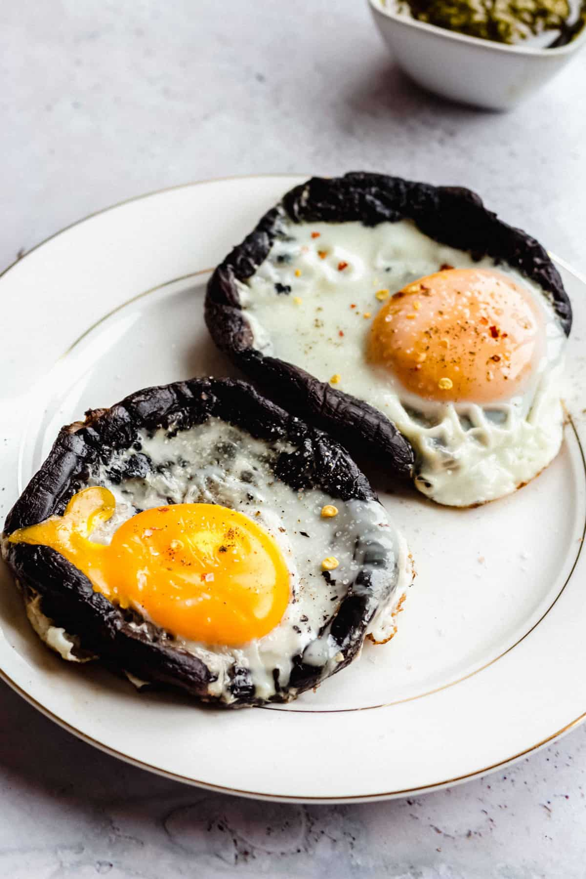 egg filled portobello mushrooms, keto friendly on plate