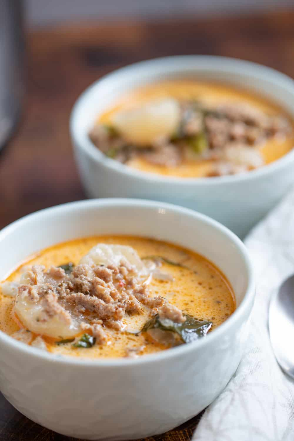 two bowls of keto friendly zuppa toscana soup